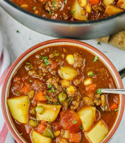 Hamburger Soup in a bowl with pot full in the back
