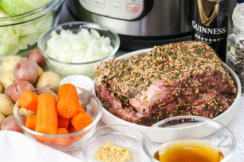 Instant Pot Corned Beef and Cabbage ingredients with instant pot in the back