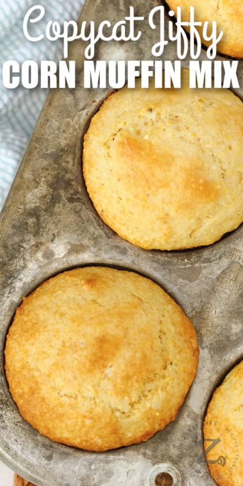 close up of Copycat Jiffy Muffin Mix muffins in a tin with writing