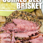 cooked Instant Pot Corned Beef and Cabbage plated with writing
