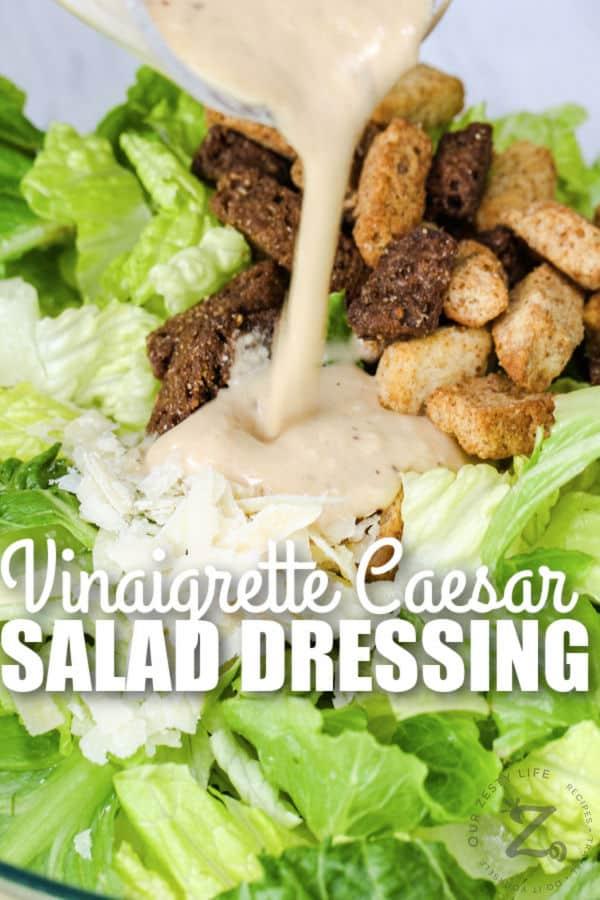 Vinaigrette Caesar Salad Dressing poured over salad with writing