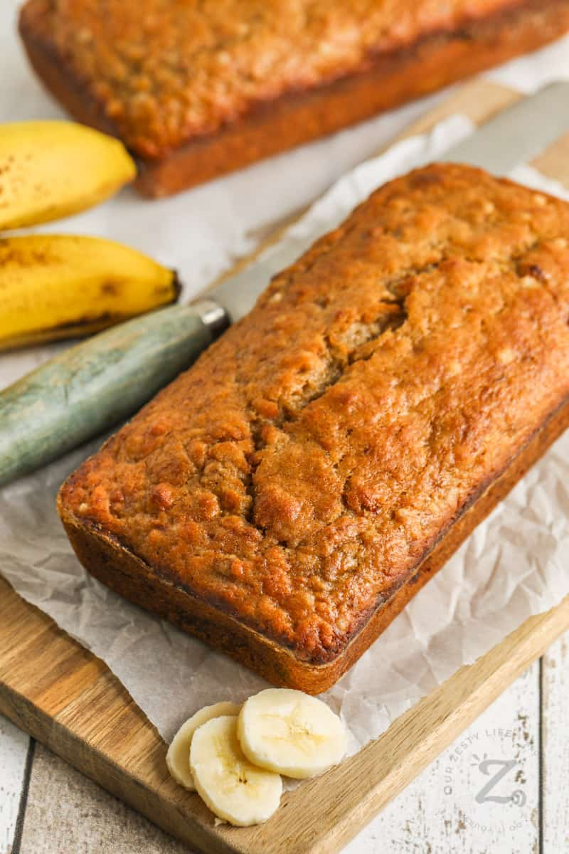 loaf of Sourdough Banana Bread with banana slices beside it