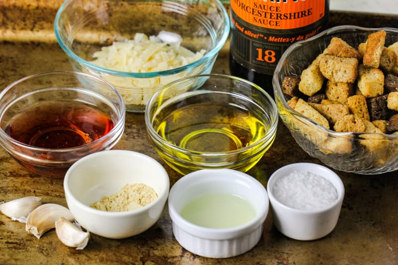 baking sheet with ingredients to make Vinaigrette Caesar Salad Dressing