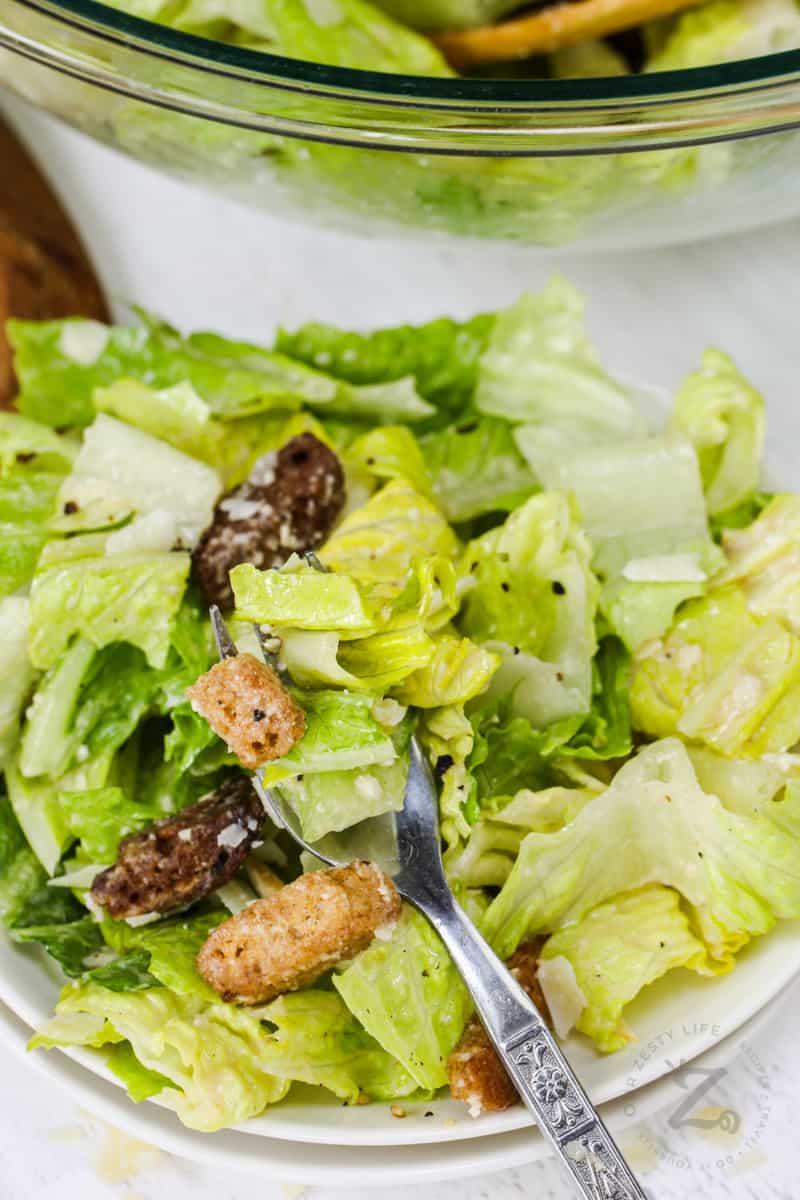 close up of Vinaigrette Caesar Salad Dressing on a fork