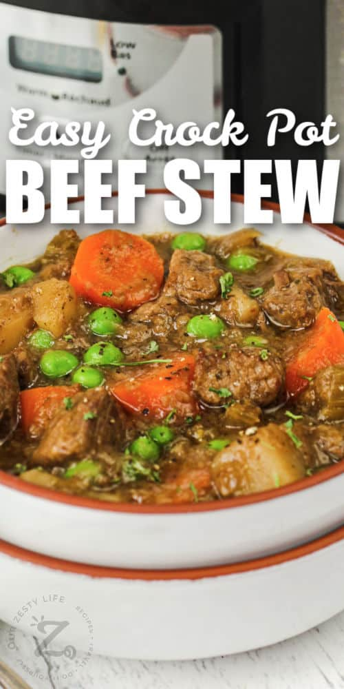 close up of bowls of Beef Stew with slow cooker in the back