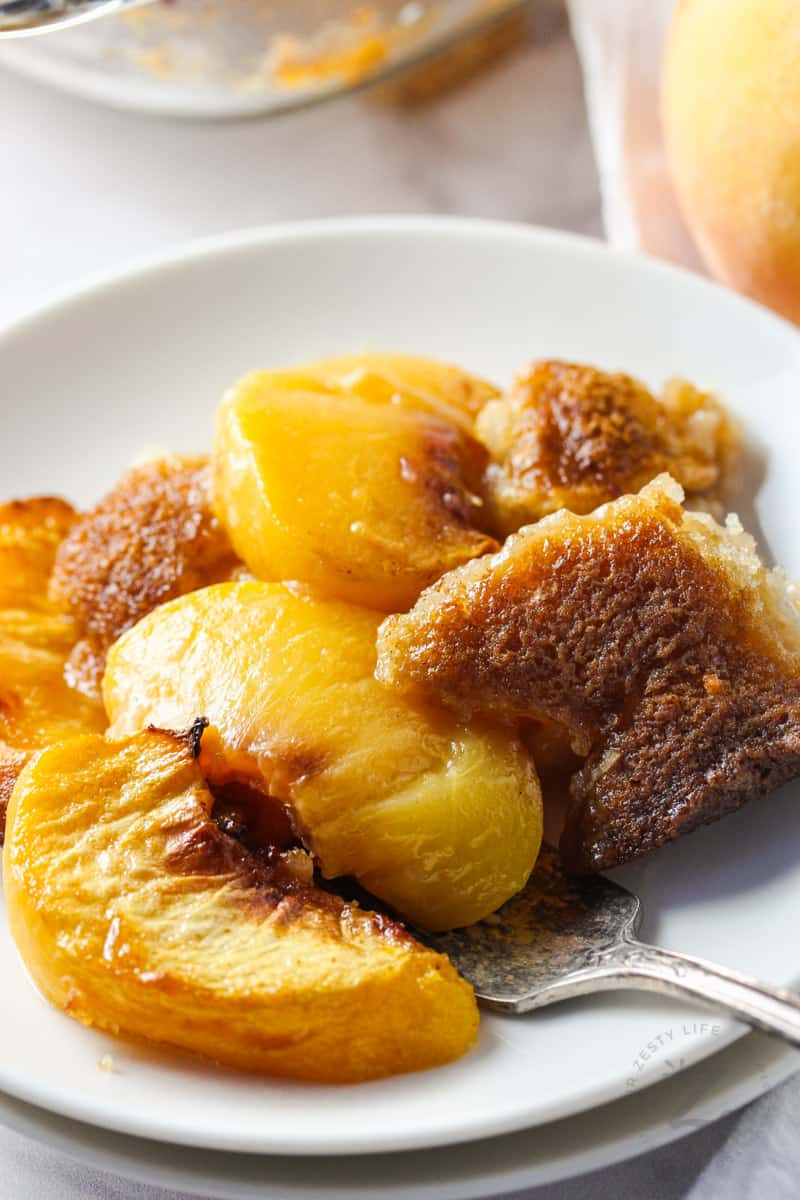Peach Cobbler with a fork on a plate