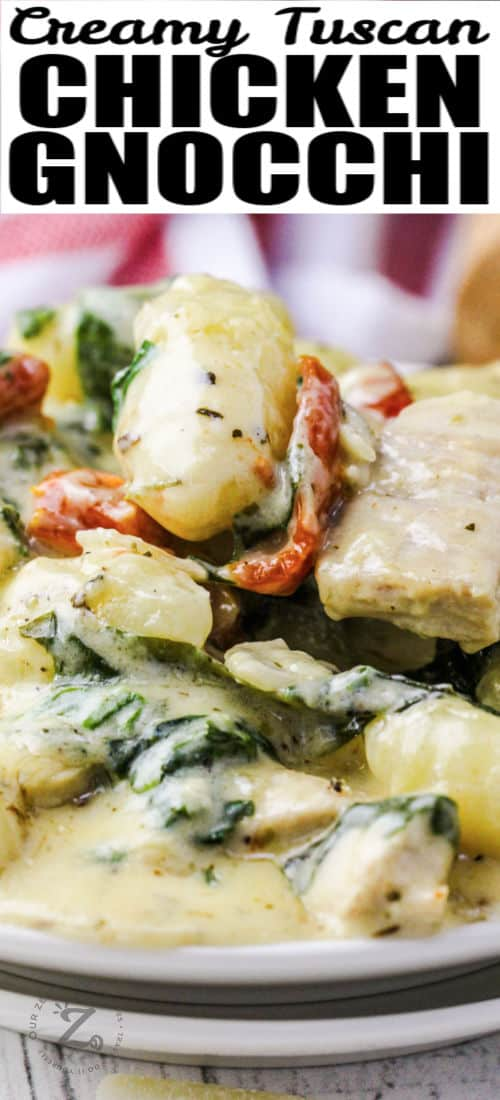 close up of Creamy Tuscan Chicken Gnocchi with a title