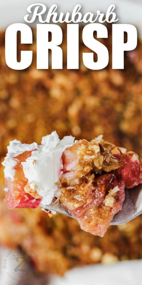 close up of Rhubarb Crisp on a fork with writing