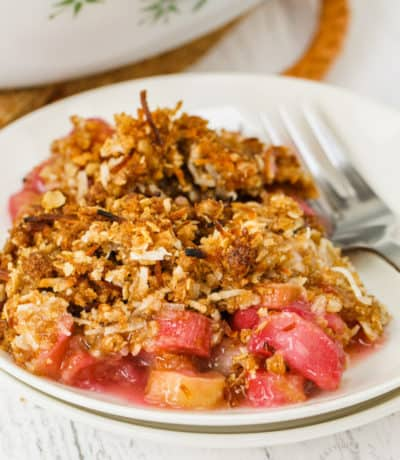 Plate full of Rhubarb Crisp with a fork
