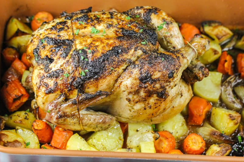 close up of cooked Roast Chicken and Vegetables in the dish