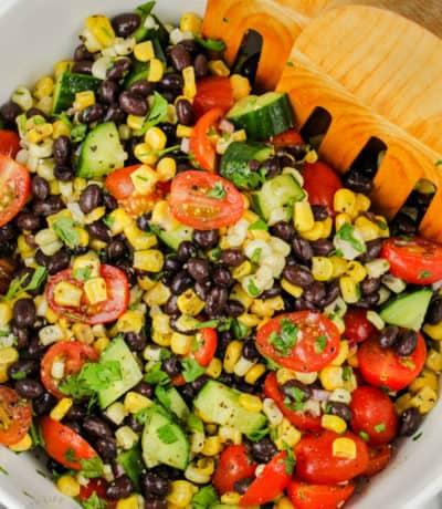 mixing ingredients to make Black Bean Corn Salad