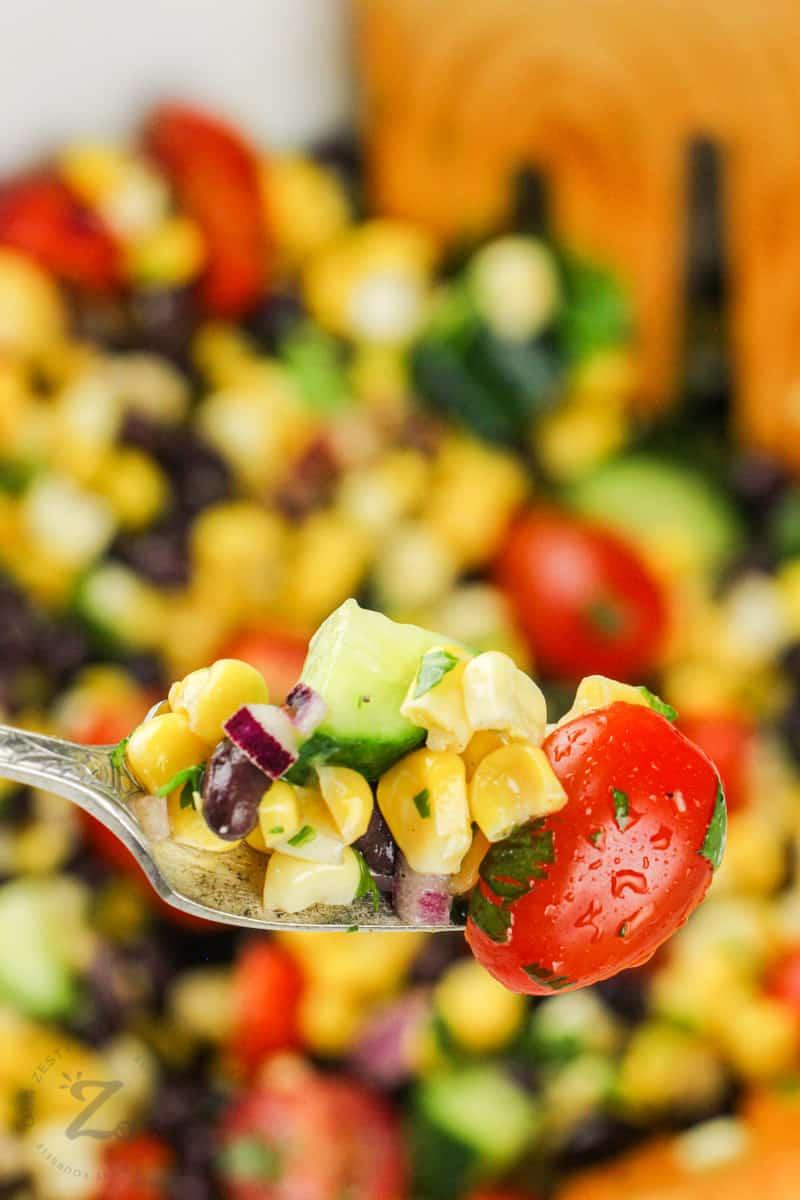 close up of Black Bean Corn Salad on a fork