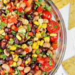 top view of Cowboy Caviar in a bowl with chips in the back