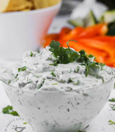 bowl of Easy Greek Yogurt Dip with chips and peppers in the back