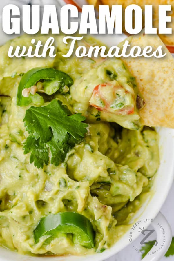 close up of Guacamole with Tomatoes with writing