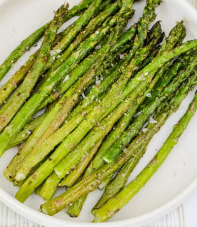 close up of Air Fryer Asparagus on a plate with salt