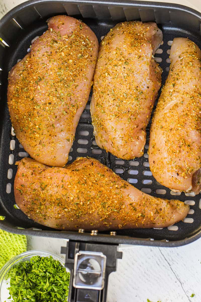 Air Fryer Chicken Breasts in the air fryer before cooking