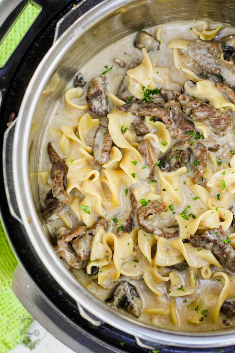 top view of Instant Pot Beef Stroganoff in the pot cooked