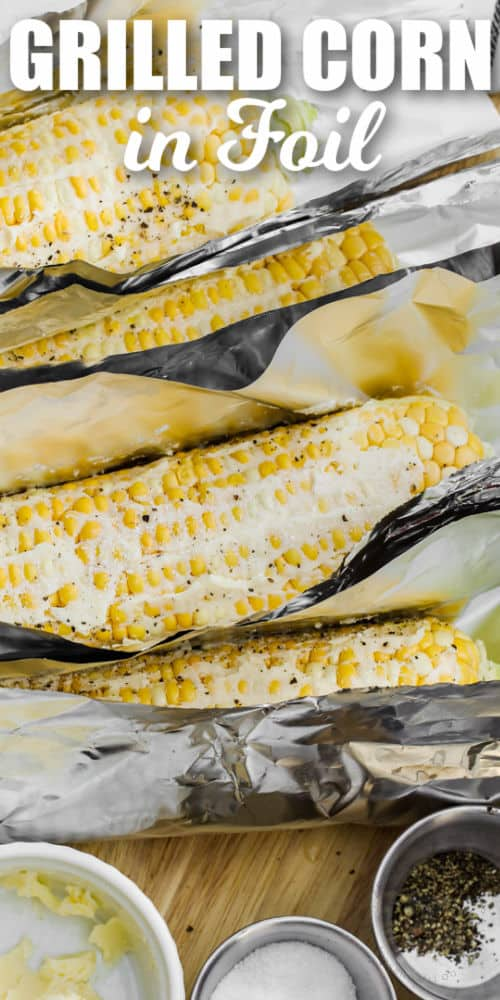 adding ingredients to foil to make Grilled Corn in Foil with writing