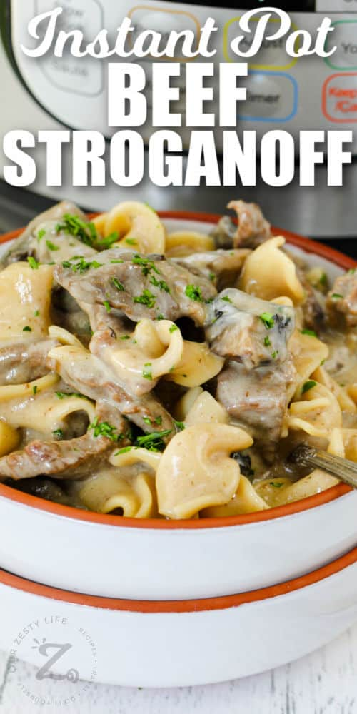 close up of plated Instant Pot Beef Stroganoff with writing