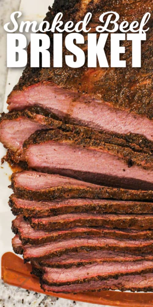top view of cooked and sliced Smoked Brisket Recipe with writing