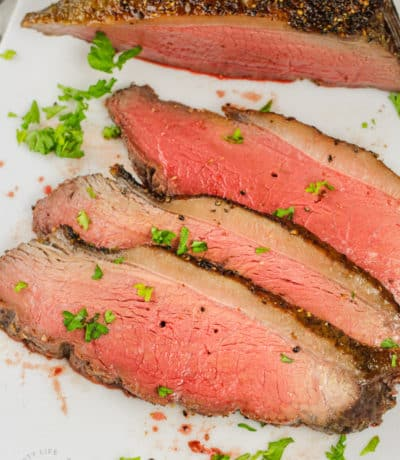 top view of sliced Picanha Roast with a knife