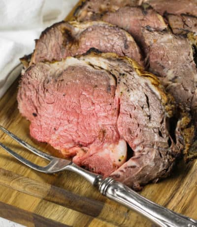 slices of Reverse Sear Prime Rib with a fork