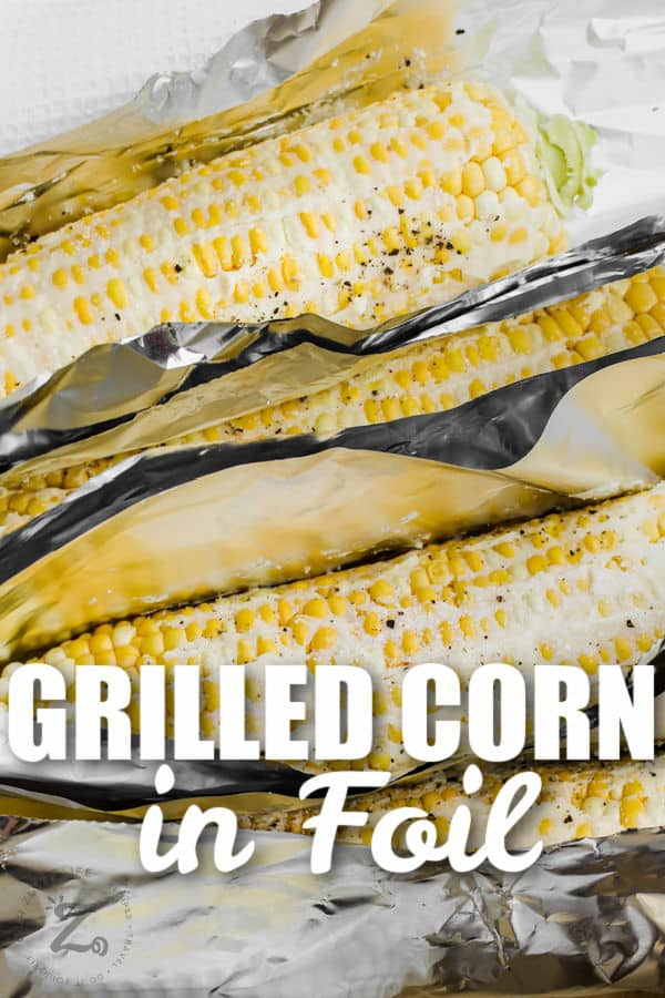 close up of Grilled Corn in Foil with a title