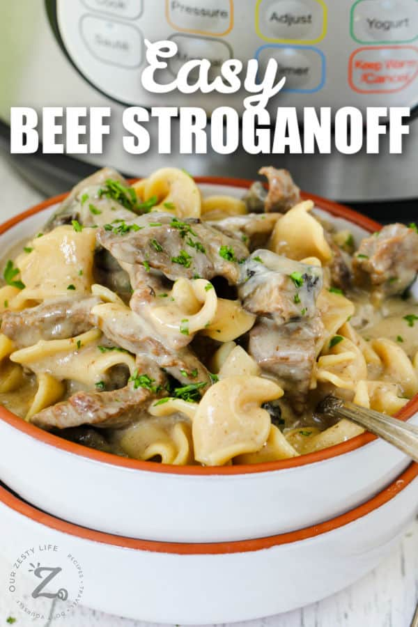 plated Instant Pot Beef Stroganoff with Instant Pot in the back and a title