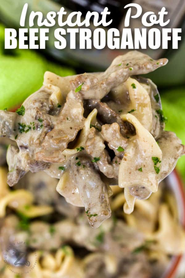 spoon full of Instant Pot Beef Stroganoff with a title