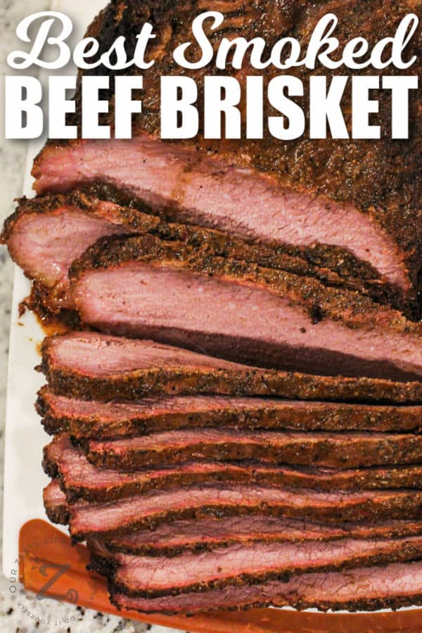 top view of sliced Smoked Brisket Recipe with a title