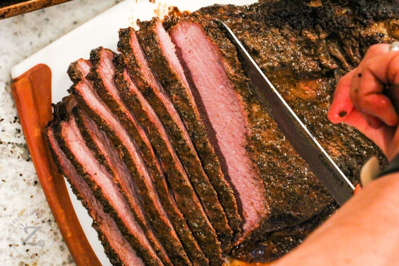 slicing Smoked Beef Brisket with a knife