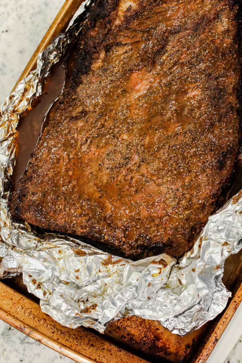 top view of cooked Smoked Beef Brisket in tin foil