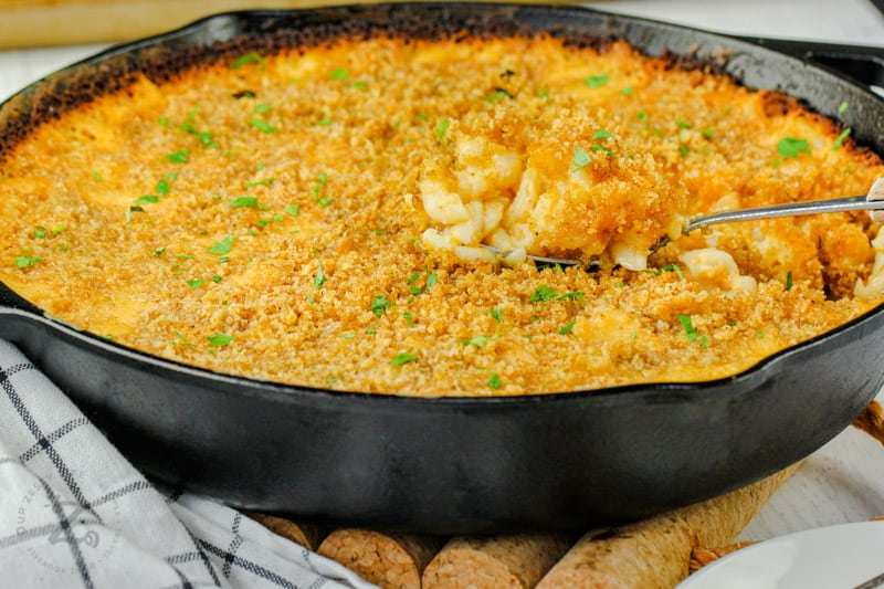pan full of Smoked Macaroni and Cheese with a spoon
