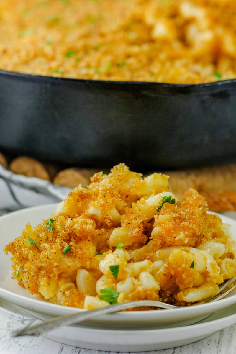 close up of Smoked Macaroni and Cheese on a plate with a fork