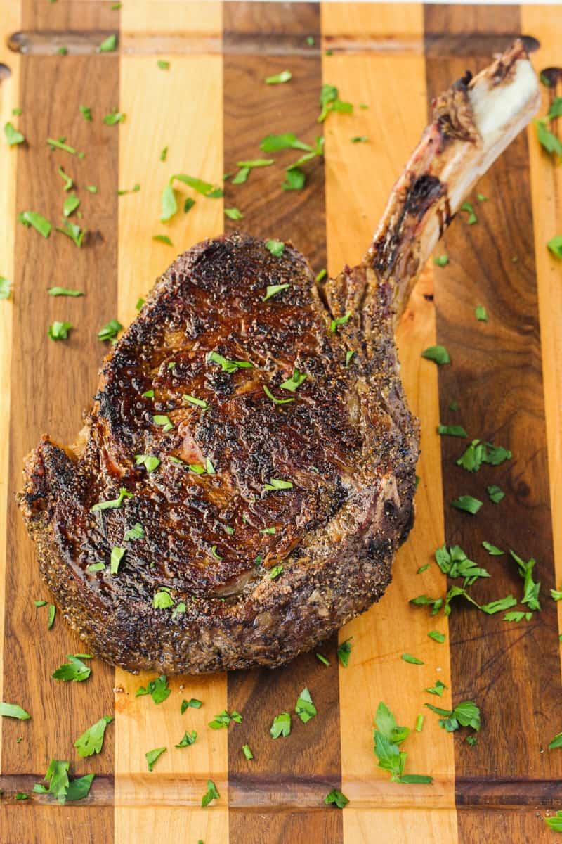 cooked Tomahawk Ribeye Steak on a cutting board