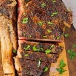 Tomahawk Ribeye Steak being cut into slices