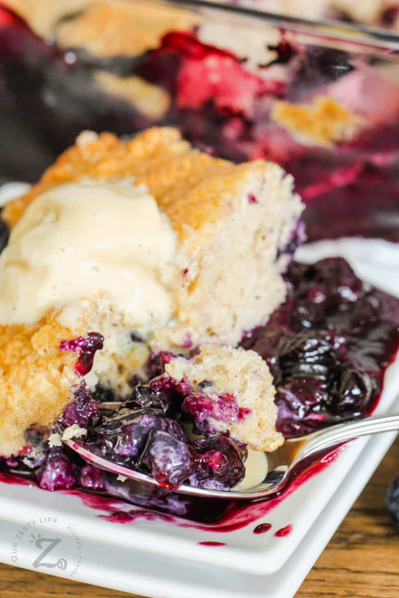 Blueberry Cobbler on a plate with spoon full