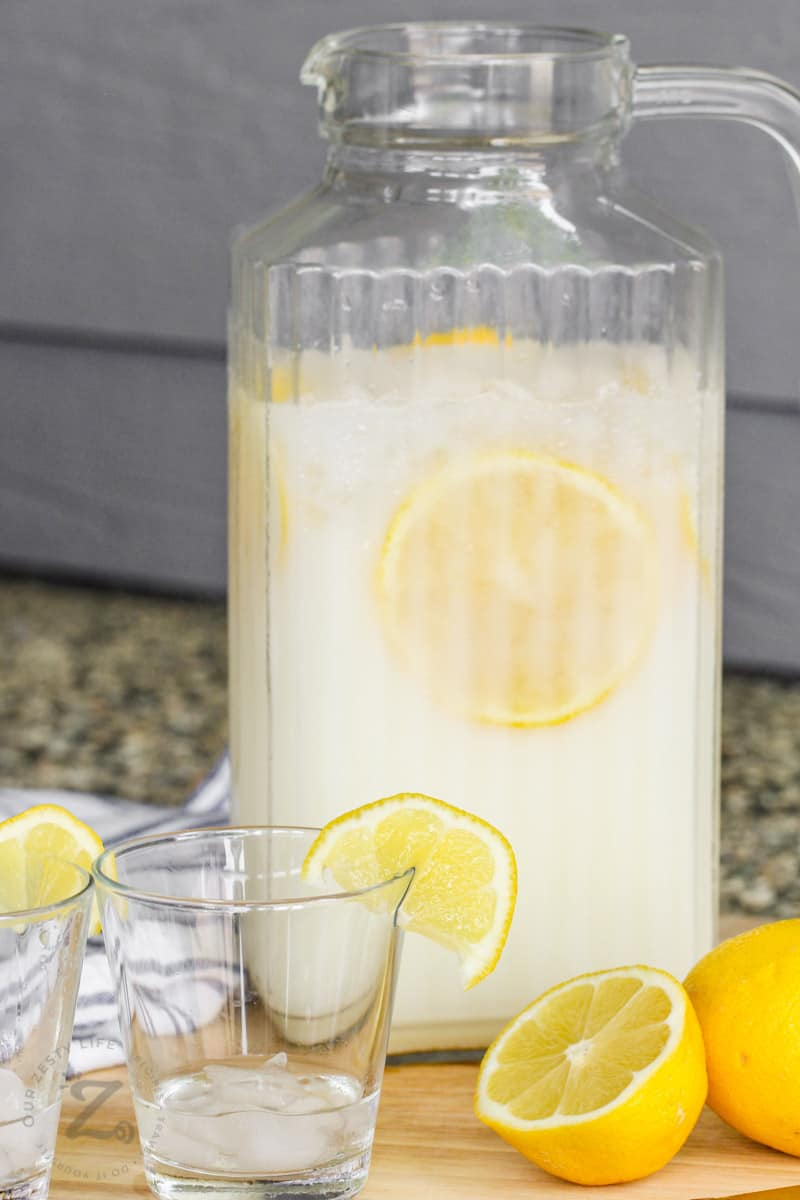 Creamy Lemonade in a jug with glasses and lemons