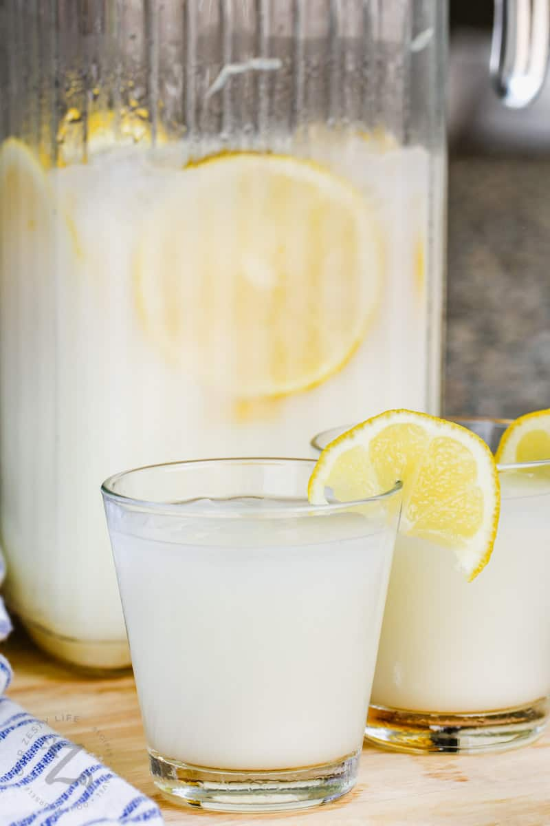 glasses of Creamy Lemonade with jug in the background