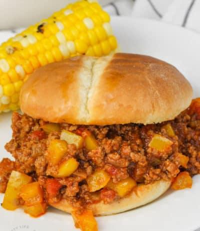 Manwich Sloppy Joe with corn on a plate