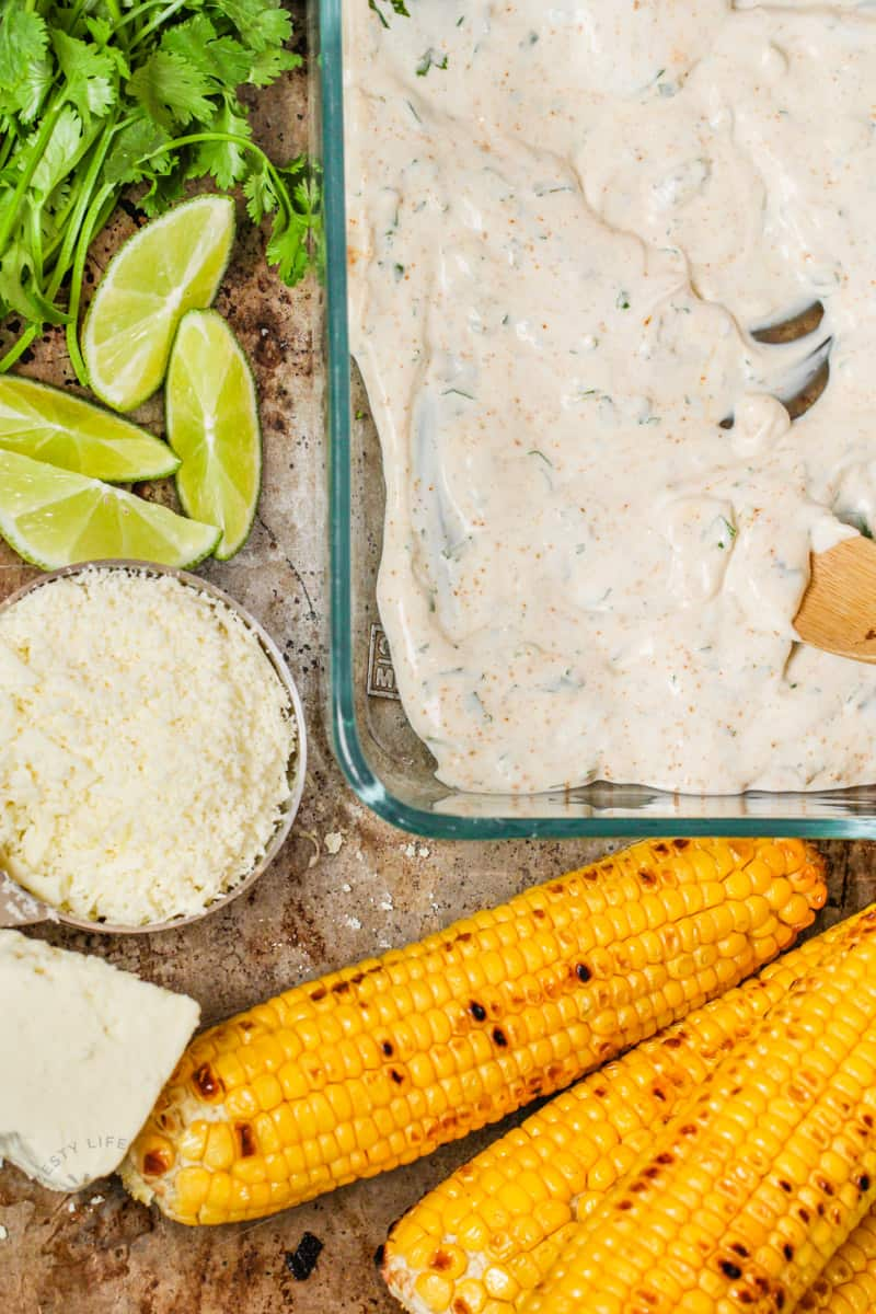 making sauce for Mexican Street Corn with ingredients around it