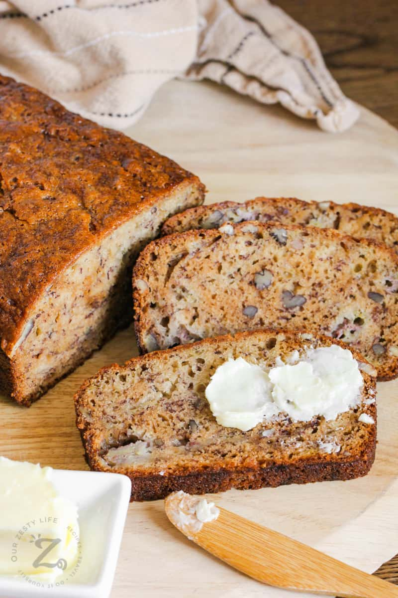 Moist Banana Bread slices with butter on top