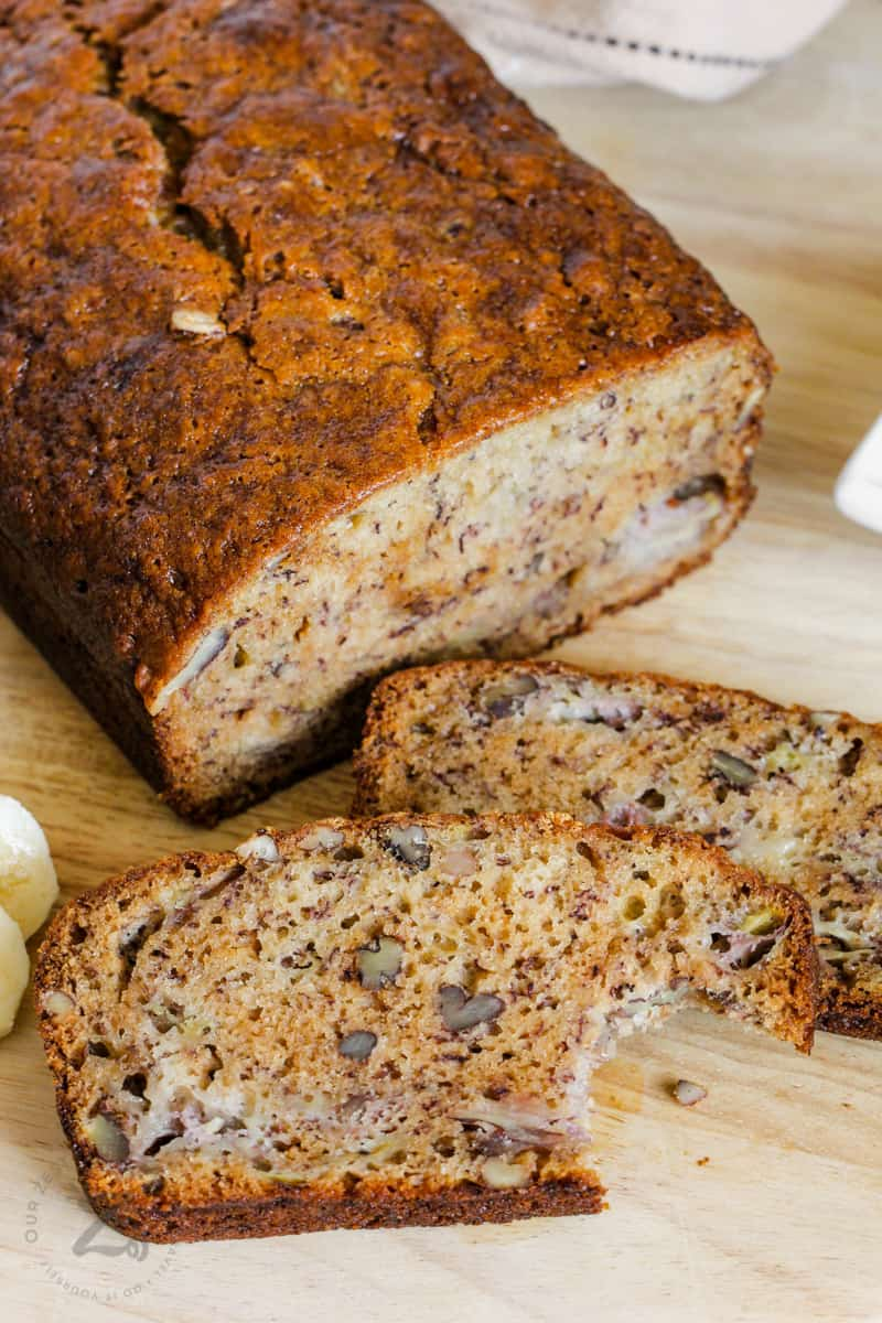 Moist Banana Bread cut and a bite taken out of one piece