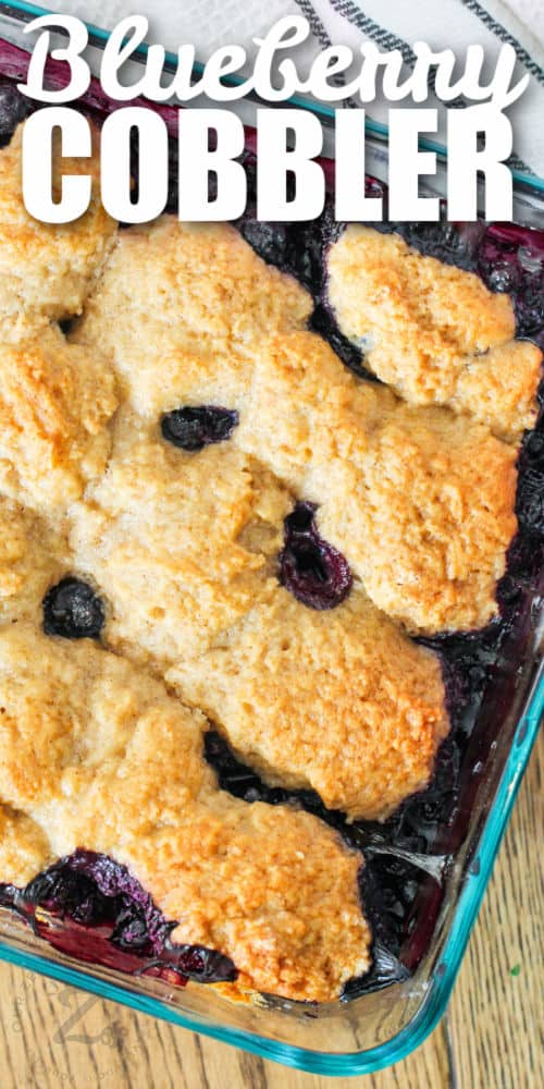 Blueberry Cobbler cooked in the pan with writing