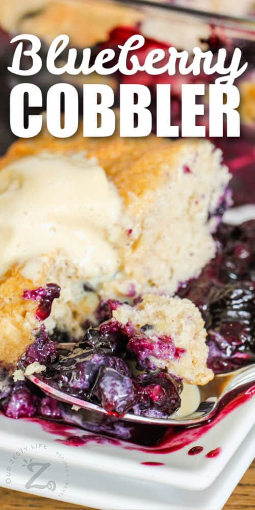 plated Blueberry Cobbler with a spoon and writing