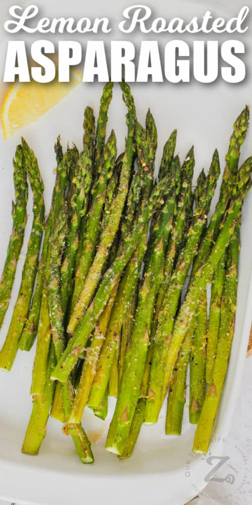 cooked Oven Roasted Asparagus with lemon and writing