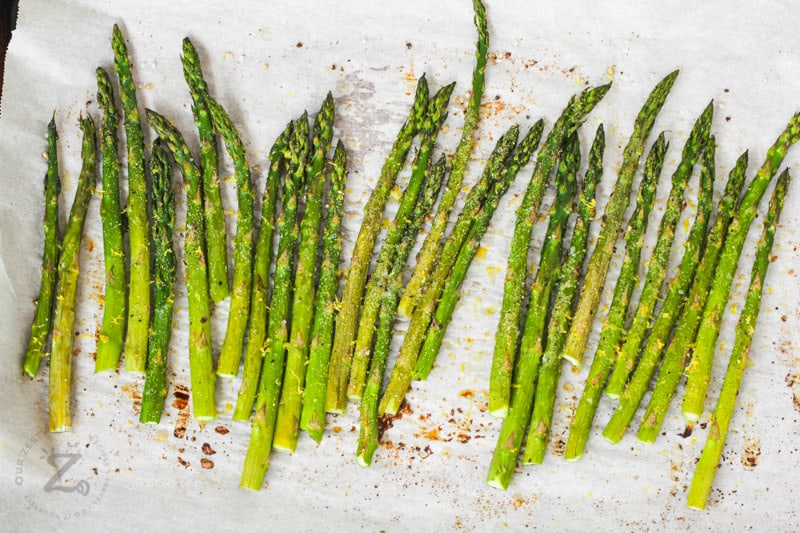 cooked Oven Roasted Asparagus on a baking sheet