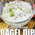 Everything Bagel Dip in a glass bowl with writing