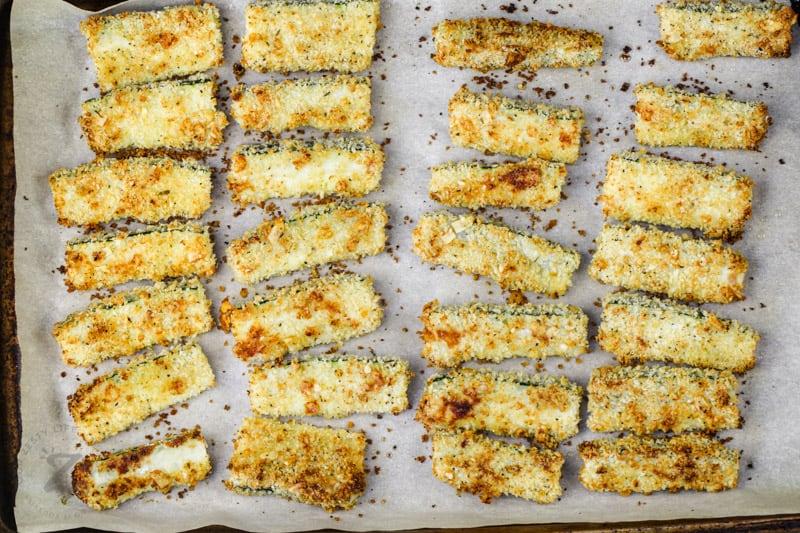 Baked Zucchini Sticks on a baking sheet